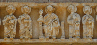 Detail of carving of Christ and the Twelve Apostles above main door of church of San Tommaso