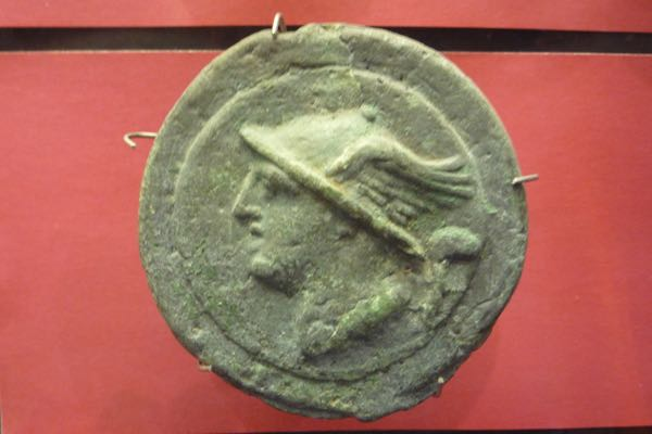 A Roman coin with the head of Mercury