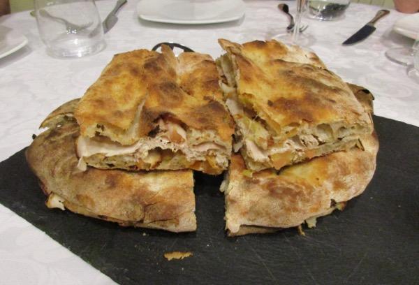 'Roman Streetfood' with porchetta, onion and tomato